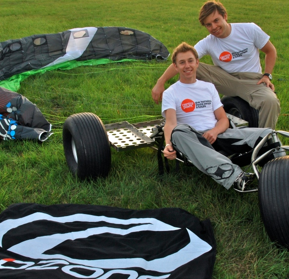 Charlie (left) and Harry (right) with one of their outlaw buggies, an 11m Ozone Frenzy kite, and their Centrepoint t shirts!