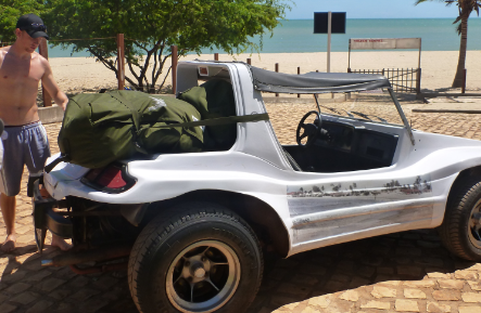 Loading the buggies onto a dune buggy for the first stage of the trip to Fortaleza
